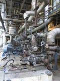 Motores elétricos que conduzem as bombas de água industriais durante o reparo Fotografia de Stock Royalty Free