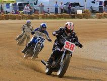 Motorfietsenstrijd voor het lood stock foto