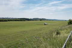 Motorglider just landed on grass Royalty Free Stock Photography