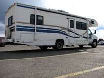 Motorhome 4. The right side view, from the rear, of a white motor home in a parking lot Royalty Free Stock Photos