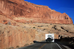 Motorhome in Arches National Park, Utah. A motorhome driving on a road through Arches National Park in Utah, USA. This park is a  popular scenic destination Stock Images