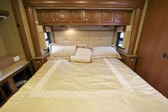 Motorhome Bed. Motorhome Comfortable King Size Bed Inside the Slider. RV Interior Royalty Free Stock Images