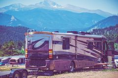 Motorhome Camping. Camping in the Motorhome in the Scenic Colorado RV Park. Class A Diesel Pusher Motorhome royalty free stock images