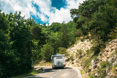 Motorhome Car Goes On Road On Background Of French Mountain Nature Royalty Free Stock Photo