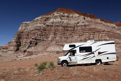 Motorhome in Desert Wilderness. Travelers parked their motorhome to go explore this desert wilderness Royalty Free Stock Photo