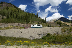 Motorhome in the mountains. Traveling in a recreational vehicle on a mountain road in Colorado Royalty Free Stock Photography