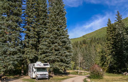 Motorhome at a national forrest campground Stock Images