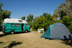 Motorhome parked at campsite. Small european motorhome parked at campsite in France stock photos