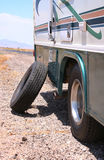 Motorhome RV Flat in Desert. Inner tire flat on the road in the American West, between Nevada and Arizona Royalty Free Stock Photos