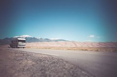 Motorhome RV Travel. Recreation Vehicle with a Tow on the Colorado Road near Great Sand Dunes. Traveling in Class A RV Motorhome in America Stock Photos