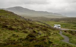 Motorhome touring in the Scottish Highlands. A view over the Highlands of Scotland with a motorhome parked up in a layby along the North Coast 500 route royalty free stock photo