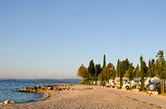 Motorhomes campsite at Garda Lake coastline. Garda Lake coastline with motorhomes campsite, Italy royalty free stock images