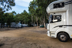 Motorhomes at campsite. Motorhomes at the campsite by the water stock image