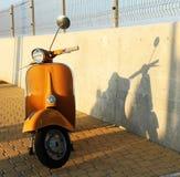 Motorino arancio Fotografia Stock