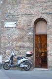 Motorino. Classical Italian motorroler on the street of Italian city Royalty Free Stock Photography