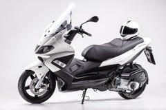 Motorino con un casco Immagine Stock