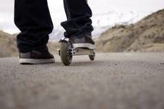 Motorino di guida del bambino sul percorso Fotografia Stock Libera da Diritti
