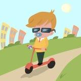 Motorino moderno di guida del bambino Fotografie Stock