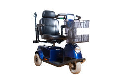 Motorised wheelchair with basket for disposable people Royalty Free Stock Photography