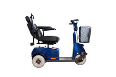 Motorised wheelchair for disposable people. Motorised wheelchair with basket for disposable people Stock Images