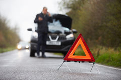 Motorist Broken Down On Country Road Phoning For Help Royalty Free Stock Photography