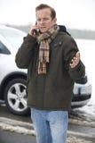 Motorist Broken Down In Snowy Countryside Royalty Free Stock Photos