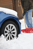 Motorist Digging Car Out Of Snow Stock Photo