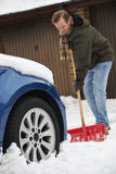 Motorist Digging Car Out Of Snow Stock Images