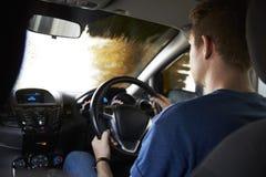 Motorist Driving Through Automated Car Wash Stock Photo