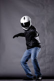 Motorist with a helmet, leather jacket and jeans Stock Image