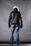 Motorist with a helmet, leather jacket and jeans Stock Photos