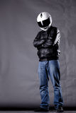 Motorist with a helmet, leather jacket and jeans Stock Images