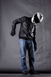 Motorist with a helmet, leather jacket and jeans Stock Photography