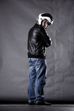 Motorist with a helmet, leather jacket and jeans Royalty Free Stock Photo