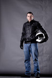 Motorist with a helmet, leather jacket and jeans Stock Photo