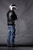 Motorist with a helmet, leather jacket and jeans Royalty Free Stock Image