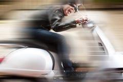 Motorista do 'trotinette' em um passeio louco Imagem de Stock Royalty Free