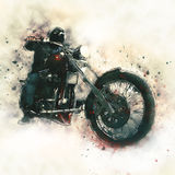 Motorista en una motocicleta Foto de archivo libre de regalías