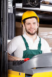 Motorista feliz da empilhadeira Imagens de Stock Royalty Free