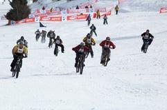 Motoristas de la nieve en la raza Imagen de archivo libre de regalías