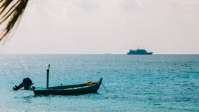 Motorized boat near cruise liner. At Indian Ocean Royalty Free Stock Photos