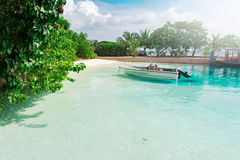 Motorized boat at transparent water at tropical island Stock Photography