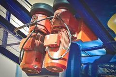 Motorized Drive Unit of Roller Coaster at Amusement Park. Orange Motorized Drive Unit of Roller Coaster at Amusement Park Stock Image