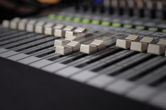 Motorized fader on a studio mixing desk. Motorized fader motion blur on a studio mixing desk stock photography