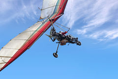 Motorized hang glider. The motorized hang glider in the blue sky Royalty Free Stock Photos