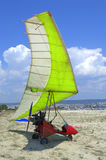Motorized hang glider on the beach Stock Images