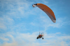 The motorized hang glider in the blue sky Royalty Free Stock Image