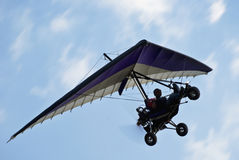 Motorized Hang Glider in Flight. Microlight flying is an adventure sport that provides people of all ages with one of the best opportunities to fly free as a Stock Images