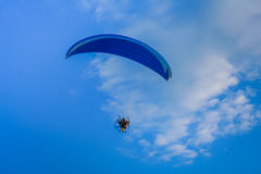 Motorized hang glider 1. Motorized hang glider flying 1 royalty free stock photography