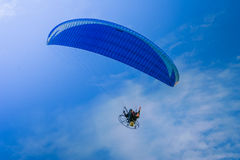 Motorized hang glider 2. Motorized hang glider flying 2 Royalty Free Stock Image